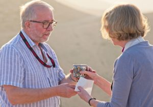 Graham receiving Communion in the Judean Desert (Photo: Huw Riden)